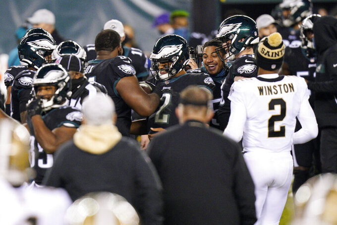 Philadelphia Eagles' Jalen Hurts celebrates with teammates after winning an NFL football game against the New Orleans Saints, Sunday, Dec. 13, 2020, in Philadelphia. (AP Photo/Chris Szagola)