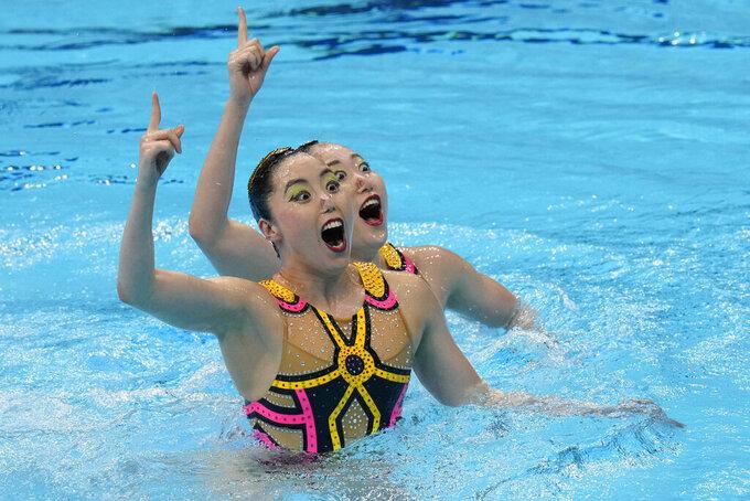 Yukiko Inui and Megumu Yoshida, of Japan, compete in the Duet Free Routine Preliminary at the Tokyo Aquatics Centre at the 2020 Summer Olympics, Monday, Aug. 2, 2021, in Tokyo, Japan. (AP Photo/Alessandra Tarantino)