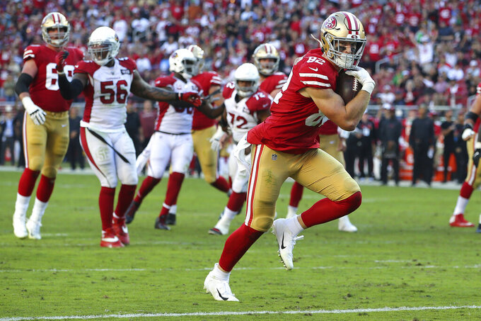 San Francisco 49ers tight end Ross Dwelley (82) scores against the Arizona Cardinals during the second half of an NFL football game in Santa Clara, Calif., Sunday, Nov. 17, 2019. (AP Photo/John Hefti)