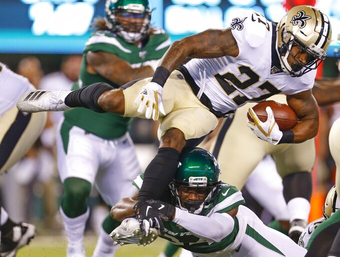 New York Jets' Brian Poole tackles New Orleans Saints' Dwayne Washington (27) during the first half of a preseason NFL football game Saturday, Aug. 24, 2019, in East Rutherford, N.J. (AP Photo/Adam Hunger)