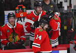 Chicago Blackhawks left wing Chris Kunitz (14) celebrates with right wing Patrick Kane (88) and center Jonathan Toews (19) after scoring a goal against the Dallas Stars during the second period of an NHL hockey game Friday, April 5, 2019, in Chicago. (AP Photo/Matt Marton)