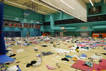 Belongings of protesters are left in the gymnasium of the Polytechnic University in Hong Kong, Thursday, Nov. 21, 2019. A small group of protesters refused to leave the Hong Kong Polytechnic University, the remnants of hundreds who took over the campus for several days. (AP Photo/Vincent Thian)