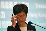 Hong Kong Chief Executive Carrie Lam attends a press conference in Hong Kong Friday, Oct. 4, 2019. Lam has banned protesters from wearing masks to conceal their identities in a hardening of the government's stance against the 4-month-old demonstrations. (AP Photo/Vincent Thian)