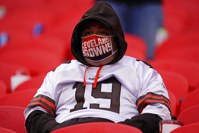A Cleveland Browns fan watches from the stands during the second half of an NFL divisional round football game against the Kansas City Chiefs, Sunday, Jan. 17, 2021, in Kansas City. (AP Photo/Jeff Roberson)