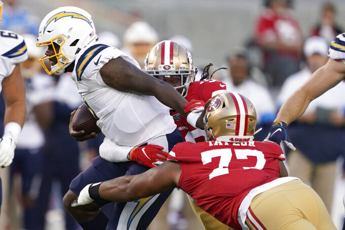 Los Angeles Chargers quarterback Cardale Jones, left, runs against San Francisco 49ers defensive tackle Jullian Taylor, front, and defensive back Marcell Harris, rear, during the first half of an NFL preseason football game in Santa Clara, Calif., Thursday, Aug. 29, 2019. (AP Photo/Tony Avelar)