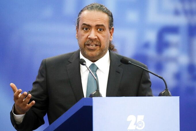 """FILE - In this Friday, Oct. 21, 2016 file photo, Kuwait's Sheikh Ahmad Al-Fahad Al-Ahmed Al-Sabah, president of the Association of National Olympic Committees (ANOC) speaks at the European Olympic Committees General Assembly in Minsk, Belarus. Documents obtained by The Associated Press show two senior Olympic officials from Kuwait have been targeted by the U.S. Department of Justice for suspected racketeering and bribery related to FIFA and international soccer politics. Sheikh Ahmad Al-Fahad Al-Ahmed Al-Sabah is reputed to be the """"kingmaker"""" of IOC elections. Husain al-Musallam is president of swimming's international governing body. The documents include details of the DOJ investigation and a formal request to Kuwaiti authorities in 2017 for help to secure evidence. (AP Photo/Sergei Grits, File)"""