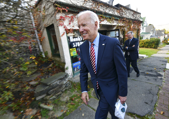Former U.S. Vice President Joe Biden leaves Hank's Hogies with some treats after speaking at the Scranton Cultural Center in Scranton Pa., on Wednesday, Oct. 23, 2019. (Jason Farmer/The Times-Tribune via AP)