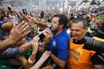 "FILE - In this Sunday, Sept. 15, 2019. file photo, leader of The League party, Matteo Salvini, is cheered by supporters at a party's rally in Pontida, northern Italy. Italy's politically battered Matteo Salvini and ally Giorgia Meloni are preparing for a weekend march on Rome to rally the right-wing after Salvini's political miscalculation got him ousted from his powerful post as interior minister. Meloni's post-fascist Brothers Of Italy party is growing in popularity as Italy's political landscape shifts even more toward the right. Salvini calls the rally ""a peaceful day of Italian pride"" but many believe it will attract far-right extremists. (AP Photo/Luca Bruno, File)"