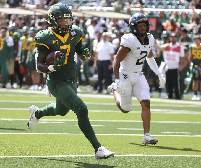 Baylor runningback Abram Smith scores past West Virginia cornerback Daryl Porter Jr., right, in the second half of an NCAA college football game, Saturday, Oct. 9, 2021, in Waco, Texas. (Rod Aydelotte/Waco Tribune-Herald via AP)