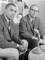 FILE - In this June 1966, file photo, Reggie Jackson, left, an outfielder from Arizona State, and the Kansas City Athletics No. 1 pick in the baseball draft, sits with team's executive vice president, Ed Lopat, after signing a contract for $85,000 in Kansas City, Mo. Baseball's amateur draft this week will look much different because of the coronavirus pandemic, and more permanent changes could be coming soon. (AP Photo/File)
