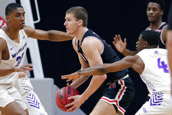 Lamar guard Anderson Kopp, center, looks to pass the ball under pressure from Abilene Christian forward Joe Pleasant, left, and Abilene Christian guard Damien Daniels (4) during the first half of an NCAA college basketball game in the Southland Conference semifinals Friday, March 12, 2021, in Katy, Texas. (AP Photo/Michael Wyke)