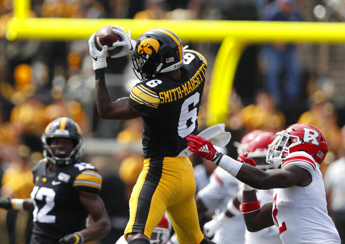 No. 20 Iowa rolls past Rutgers 30-0, Stanley throws 3 TDs