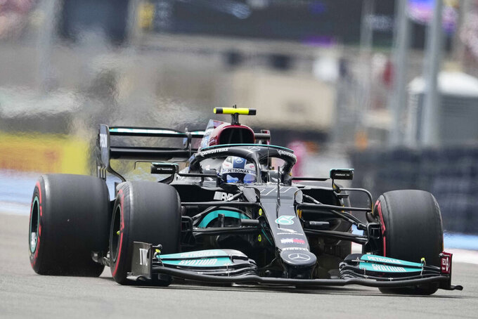 Mercedes driver Valtteri Bottas of Finland steers his car during the qualifying session ahead the French Formula One Grand Prix at the Paul Ricard racetrack in Le Castellet, southern France, Saturday, June 19, 2021. The French Grand Prix will be held on Sunday. (AP Photo/Francois Mori)