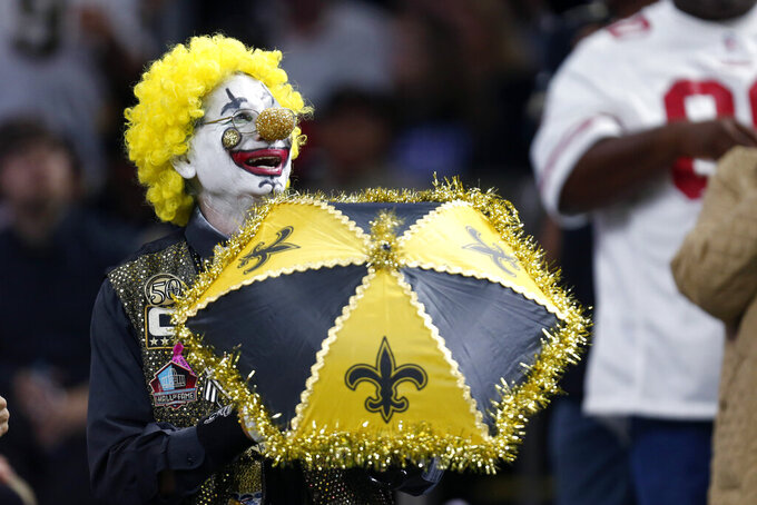 A New Orleans Saints fan dressed as a clown reacts in the stands in the first half of a high scoring NFL football game against the San Francisco 49ers in New Orleans, Sunday, Dec. 8, 2019. (AP Photo/Butch Dill)