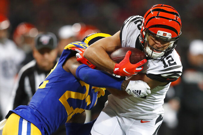Cincinnati Bengals wide receiver Alex Erickson (12) runs against Los Angeles Rams' Troy Hill during the first half of an NFL football game, Sunday, Oct. 27, 2019, at Wembley Stadium in London. (AP Photo/Frank Augstein)