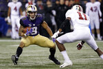Washington's Myles Gaskin (9) carries as Stanford's Paulson Adebo moves in during the first half of an NCAA college football game Saturday, Nov. 3, 2018, in Seattle. (AP Photo/Elaine Thompson)