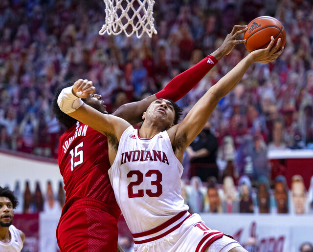 Indiana forward Trayce Jackson-Davis, right, has his shot attempt blocked by Rutgers center Myles Johnson, left, during the second half of an NCAA college basketball game, Sunday, Jan. 24, 2021, in Bloomington, Ind. (AP Photo/Doug McSchooler)