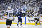 Winnipeg Jets' Mark Scheifele (55) reacts after scoring against the Vegas Golden Knights during the second period of Game 1 of the NHL hockey playoffs Western Conference final, Saturday, May 12, 2108, in Winnipeg, Manitoba. (John Woods/The Canadian Press via AP)