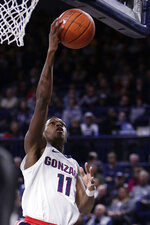 Gonzaga guard Joel Ayayi (11) shoots during the first half of an NCAA college basketball game against Texas Southern in Spokane, Wash., Wednesday, Dec. 4, 2019. (AP Photo/Young Kwak)