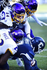 Connecticut wide receiver Cameron Ross (9) is taken down during the first half of an NCAA college football game against East Carolina, Saturday, Nov. 23, 2019, in East Hartford, Conn. (AP Photo/Stephen Dunn)