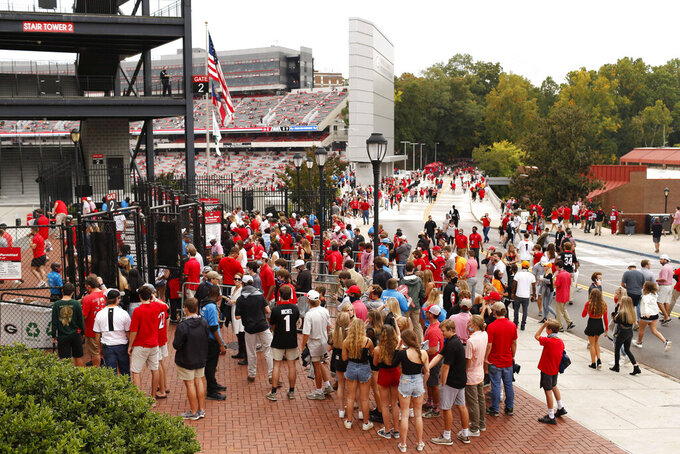 Fans wait in line to enter Sanford Stadium before the start of the Georgia-Tennessee NCAA college football game in Athens, Ga., on Saturday, Oct. 10, 2020. (Joshua L. Jones/Athens Banner-Herald via AP)