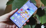 The new Huawei Mate 40 Pro smartphone is held for a photo, in London, Wednesday Oct. 21, 2020. Huawei, has unveiled its Mate 40 line of phones, Thursday Oct. 22, 2020, a product release that comes at a crucial moment for the company. (AP Photo/James Brooks)