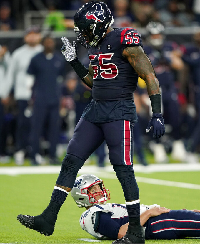 Houston Texans inside linebacker Benardrick McKinney (55) celebrates after he sacked New England Patriots quarterback Tom Brady (12) during the second half of an NFL football game Sunday, Dec. 1, 2019, in Houston. (AP Photo/David J. Phillip)