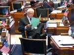 Sen. J. Rogers Pope, R-Livingston, reads legislation on the Senate floor ahead of a debate about Louisiana's budget for the financial year that begins July 1, on Friday, June 26, 2020, in Baton Rouge, La. (AP Photo/Melinda Deslatte)