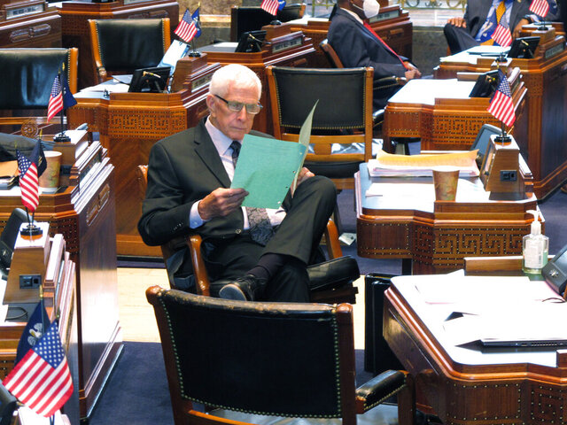 Sen. J. Rogers Pope, R-Livingston, reads legislation on the Senate floor ahead of a debate about Louisiana's budget for the financial year that begins July 1, on Friday, June 26, 2020, in Baton Rouge, La. (AP Photo/Melinda Deslatte)
