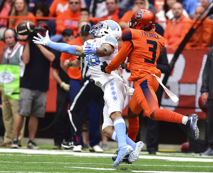 Syracuse defensive back Christopher Fredrick (3) breaks up a pass intended for North Carolina's Beau Corrales (88) during an NCAA college football game, Saturday, Oct. 20, 2018, in Syracuse, N.Y. (Scott Schild/The Post-Standard via AP)