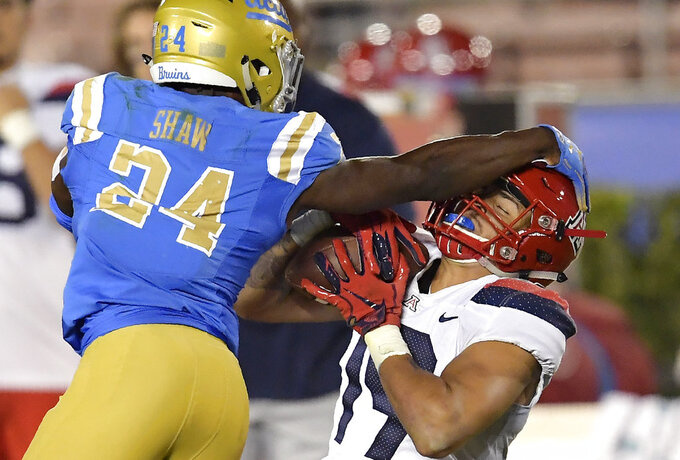 Arizona wide receiver Shawn Poindexter, right, makes a catch as UCLA defensive back Jay Shaw defends during the second half of an NCAA college football game Saturday, Oct. 20, 2018, in Pasadena, Calif. UCLA won 31-30. (AP Photo/Mark J. Terrill)