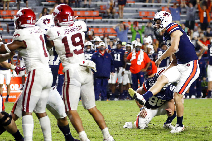 FILE - In this Oct. 10, 2020, file photo, Auburn's Anders Carlson (26) kicks the go-ahead field goal against Arkansas during the second half of an NCAA college football game in Auburn, Ala. Carlson, who played a pivotal role in last season's 48-45 Auburn win over Alabama, has made 11 of 12 field goals. (AP Photo/Butch Dill, File)