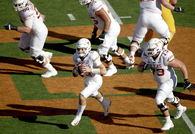 Texas quarterback Sam Ehlinger (11) scrambles with the ball against Baylor during an NCAA college football game on Saturday, Nov. 23, 2019, in Waco, Texas. (Nick Wagner/Austin American-Statesman via AP)