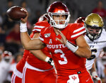 Houston quarterback Clayton Tune (3) throws a pass during the first half of an NCAA college football game against Navy, Saturday, Nov. 30, 2019, in Houston. (AP Photo/Eric Christian Smith)