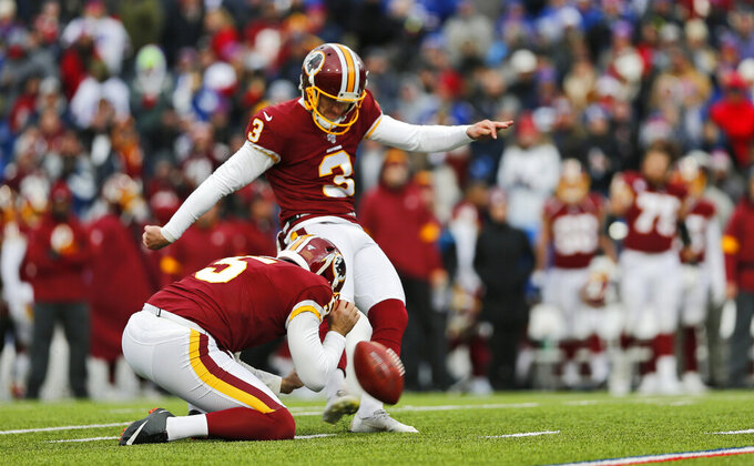 Washington Redskins kicker Dustin Hopkins (3) kicks a 33-yard field goal during the first half of an NFL football game against the Buffalo Bills, Sunday, Nov. 3, 2019, in Orchard Park, N.Y. (AP Photo/John Munson)