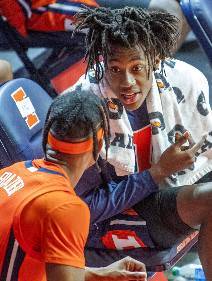 Illinois guards Ayo Dosunmu, right, and Trent Frazier (1) chat on the bench during the second half of an NCAA college basketball game against Chicago State in Champaign, Ill., Thursday, Nov. 26, 2020. (Robin Scholz/The News-Gazette via AP)