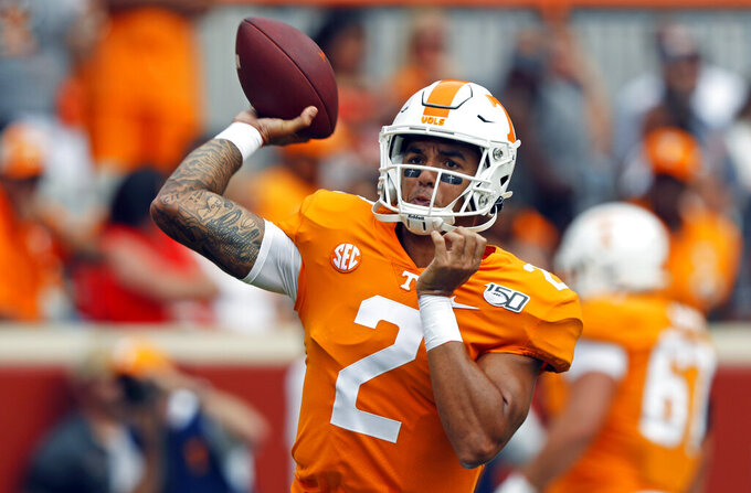Tennessee quarterback Jarrett Guarantano (2) throws to a receiver during warmups before an NCAA college football game against Chattanooga Saturday, Sept. 14, 2019, in Knoxville, Tenn. (AP Photo/Wade Payne)