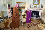 FILE - In this Wednesday March 7, 2018 file photo, Queen Elizabeth II greets Saudi Arabian Crown Prince of Saudi Arabia Mohammed bin Salman, during a private audience at Buckingham Palace in London. (Dominic Lipinski/Pool via AP)