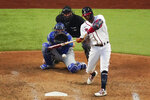 Atlanta Braves' Cristian Pache hits a home run against the Los Angeles Dodgers during the third inning in Game 3 of a baseball National League Championship Series Wednesday, Oct. 14, 2020, in Arlington, Texas. (AP Photo/Sue Ogrocki)