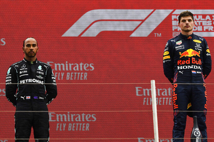 Red Bull driver Max Verstappen of the Netherlands, right, celebrates from the podium after winning the French Formula One Grand Prix next to second place Mercedes driver Lewis Hamilton of Britain, left, at the Paul Ricard racetrack in Le Castellet, southern France, Sunday, June 20, 2021. (Nicolas Tucat/Pool via AP)