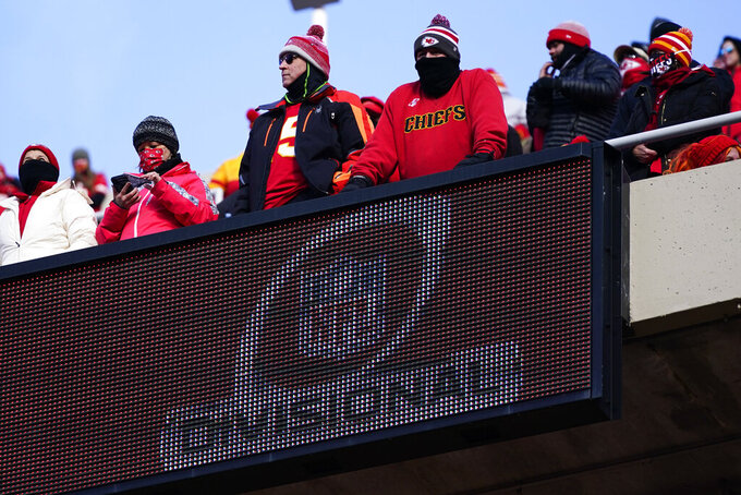Fans watch from the stands during the first half of an NFL divisional round football game between the Kansas City Chiefs and the Cleveland Browns, Sunday, Jan. 17, 2021, in Kansas City. (AP Photo/Jeff Roberson)