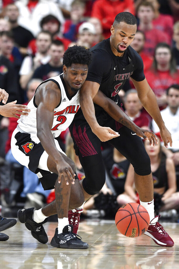 North Carolina Central forward Jibri Blount, right, battles Louisville guard Darius Perry, left, for the ball during the first half of an NCAA college basketball game in Louisville, Ky., Sunday, Nov. 17, 2019. (AP Photo/Timothy D. Easley)