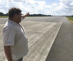 In this Sept. 11, 2019 photo, Natchitoches Regional Airport director Larry Cooper points down the runway in Natchitoches, La., where singer Jim Croce and five others died in a plane crash on Sept. 20, 1973 (Greg Hilburn/The News-Star via AP)