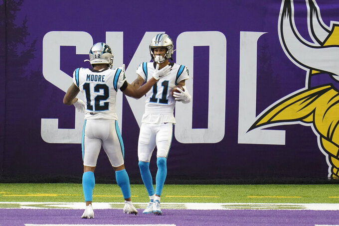 Carolina Panthers wide receiver Robby Anderson (11) celebrates with teammate DJ Moore (12) after catching a 41-yard touchdown pass during the first half of an NFL football game against the Minnesota Vikings, Sunday, Nov. 29, 2020, in Minneapolis. (AP Photo/Jim Mone)