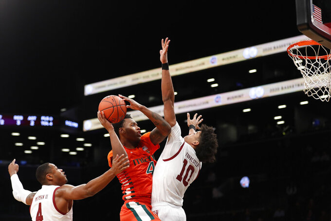 Miami's Keith Stone (4) shoots over Temple's Jake Forrester (10) during the first half of an NCAA college basketball game at Barclays Center, Tuesday, Dec. 17, 2019, in New York. (AP Photo/Michael Owens)