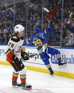 Anaheim Ducks' Josh Mahura (76) skates off as St. Louis Blues' Vince Dunn (29) celebrates his goal during the second period of an NHL hockey game Saturday, Nov. 16, 2019, in St. Louis. (AP Photo/Scott Kane)