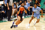 Houston guard Cameron Tyson (5) looks to pass in front of Tulane guards Jaylen Forbes (25) and Gabe Watson (0) in the first half of an NCAA college basketball game in New Orleans, Thursday, Jan. 28, 2021. (AP Photo/Tyler Kaufman)