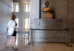 A capitol employee walks past a bust of Confederate general and early Ku Klux Klan leader Nathan Bedford Forrest at the State Capitol Thursday, July 22, 2021, in Nashville, Tenn. A decadeslong effort to remove the bust from the Tennessee Capitol cleared its final hurdle Thursday, with state leaders approving the final vote needed to allow the statue to be relocated to a museum. (George Walker IV/The Tennessean via AP)