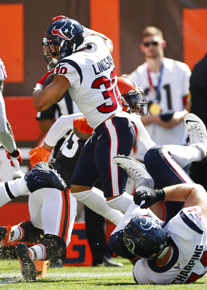 Houston Texans running back Phillip Lindsay (30) runs for a 22-yard touchdown during the first half of an NFL football game against the Cleveland Browns, Sunday, Sept. 19, 2021, in Cleveland. (AP Photo/Ron Schwane)
