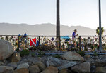 A memorial for the victims of the Conception is seen on the Santa Barbara Harbor in Santa Barbara, Calif., Sunday, Sept. 8, 2019. Authorities served search warrants Sunday at the Southern California company that owned the scuba diving boat that caught fire and killed 34 people last week. (AP Photo/ Christian Monterrosa)